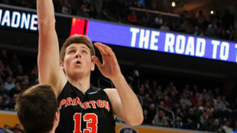 Princeton forward Will Gladson (13) goes up for a shot against Notre Dame during the second half of a first-round men's college basketball game in the NCAA Tournament, Thursday, March 16, 2017, in Buffalo, N.Y. (AP Photo/Jeffrey T. Barnes)