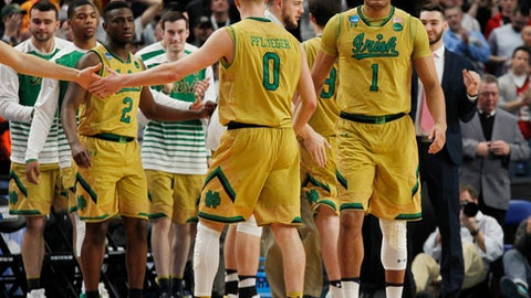 Notre Dame celebrates a 60-58 victory over Princeton during the first-round men's college basketball game in the NCAA Tournament, Thursday, March 16, 2017, in Buffalo, N.Y. (AP Photo/Jeffrey T. Barnes)