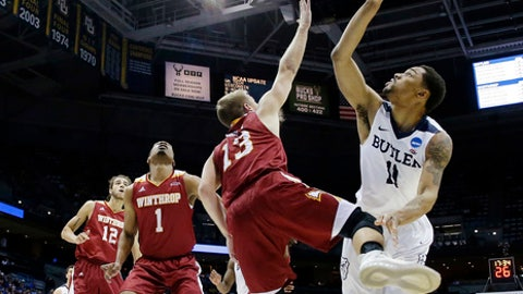 Butler's Kethan Savage (11) shoots against Winthrop's Bjorn Broman (13) during the first half of a first-round men's college basketball game in the NCAA Tournament, Thursday, March 16, 2017,  in Milwaukee. (AP Photo/Morry Gash)