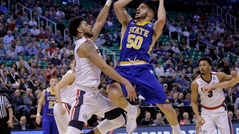 South Dakota State guard Michael Orris (50) goes to the basket as Gonzaga guard Josh Perkins (13) defends during the first half of a first-round men's college basketball game in the NCAA Tournament Thursday, March 16, 2017, in Salt Lake City. (AP Photo/Rick Bowmer)