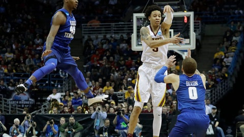 Minnesota's Amir Coffey passes around Middle Tennessee State's Tyrik Dixon and Aldonis Foote (45) during the first half of an NCAA college basketball tournament first round game Thursday, March 16, 2017, in Milwaukee. (AP Photo/Morry Gash)