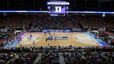 Duke players run a drill during an NCAA basketball tournament practice at Bon Secours Wellness Arena in Greenville, S.C., Thursday, March 16, 2017. For years, March brought the NCAA Tournament to basketball-crazed North Carolina like a fixture of spring. And South Carolina watched from afar, left out due to state-level politics that drew the ire of the NCAA. Those neighboring states are suddenly in reversed roles this weekend, with North Carolina _ host to more tournament games than any other state _ on the outside as South Carolina hosts its first NCAA games in 15 years (AP Photo/Chuck Burton)