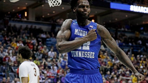 Middle Tennessee State's JaCorey Williams celebrates during the second half of an NCAA college basketball tournament first round game against Minnesota Thursday, March 16, 2017, in Milwaukee. Middle Tennessee State won 81-72. (AP Photo/Morry Gash)