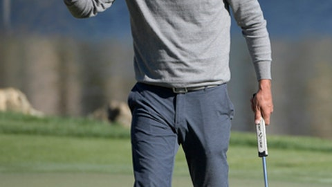Lucas Glover acknowledges the crowd after sinking his putt on the 18th green during the first round of the Arnold Palmer Invitational golf tournament in Orlando, Fla., Thursday, March 16, 2017. (AP Photo/Phelan M. Ebenhack)