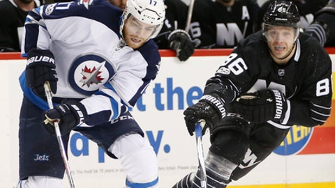 New York Islanders left wing Nikolay Kulemin (86) of Russia chases Winnipeg Jets center Adam Lowry (17) during the second period of an NHL hockey game, Thursday, March 16, 2017, in New York. (AP Photo/Kathy Willens)