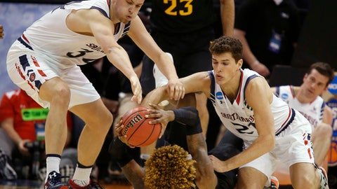 Saint Mary's center Jock Landale (34) and center Evan Fitzner (21) scramble for the ball with Virginia Commonwealth forward Justin Tillman (4) during the first half of a first-round game in the NCAA men's college basketball tournament Thursday, March 16, 2017, in Salt Lake City. (AP Photo/George Frey)