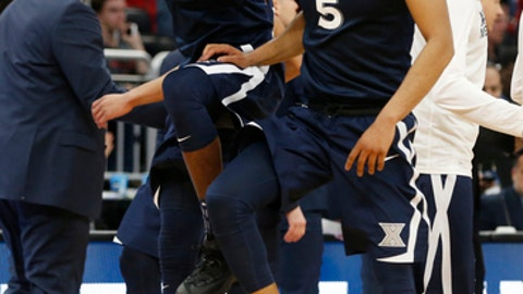 Xavier guard Malcolm Bernard, left, and guard Trevon Bluiett (5) celebrate after Xavier defeated Maryland 76-65 during the first round of the NCAA college basketball tournament, Thursday, March 16, 2017 in Orlando, Fla. (AP Photo/Wilfredo Lee)