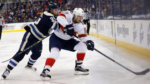 Columbus Blue Jackets' Josh Anderson, left, tries to knock Florida Panthers' Aleksander Barkov, of Finland, away from the puck during the third period of an NHL hockey game Thursday, March 16, 2017, in Columbus, Ohio. The Blue Jackets beat the Panthers 2-1. (AP Photo/Jay LaPrete)