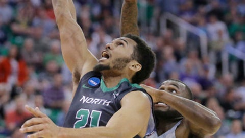 North Dakota guard Quinton Hooker (21) lays the ball up as Arizona guard Kadeem Allen (5) defends during the first half of a first-round men's college basketball game in the NCAA tournament Thursday, March 16, 2017, in Salt Lake City. (AP Photo/Rick Bowmer)