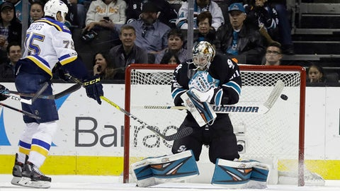 San Jose Sharks goalie Aaron Dell, right, stops a shot next to St. Louis Blues' Ryan Reaves during the second period of an NHL hockey game Thursday, March 16, 2017, in San Jose, Calif. (AP Photo/Marcio Jose Sanchez)