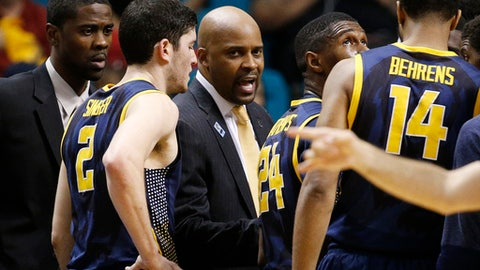 FILE - In this Thursday, March 12, 2015, file photo, California head coach Cuonzo Martin, center, speaks with his team during a timeout in the second half of an NCAA college basketball game against Arizona in the quarterfinals of the Pac-12 conference tournament in Las Vegas. Arizona won 73-51. Martin has a certain way he does things. No staying late after games to rehash film into the wee hours as is customary for so many college basketball coaches, only to return first thing in the morning to do so again. He avoids finger- pointing at one player in the heat of the moment, instead choosing to critique a specific area in which his team struggled while speaking individually with a young man when necessary. Missouri's new coach learned a lot from a cancer scare 20 years ago. (AP Photo/John Locher, File)