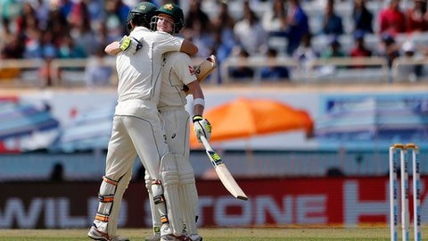 Australia's captain Steven Smith, right, hugs to congratulate teammate Glenn Maxwell on scoring a century during the second day of their third test cricket match against India in Ranchi, India, Friday, March 17, 2017. (AP Photo/Aijaz Rahi)