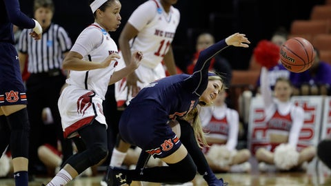 Auburn guard Katie Frerking (13) loses control of the ball as she is pressured by North Carolina State guard Miah Spencer (3) during a first-round game in the NCAA women's college basketball tournament, Friday, March 17, 2017, in Austin. (AP Photo/Eric Gay)