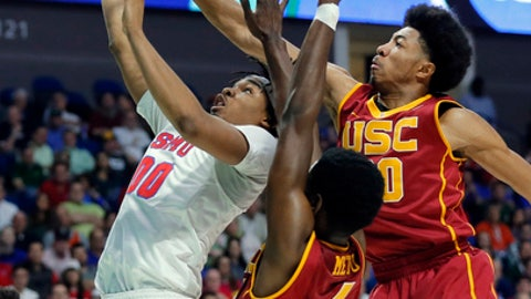 SMU's Ben Moore goes up for a shot as Southern California's Chimezie Metu (4) and Elijah Stewart, right, defend in the first half of a first-round game in the men's NCAA college basketball tournament in Tulsa, Okla., Friday March 17, 2017. (AP Photo/Tony Gutierrez)