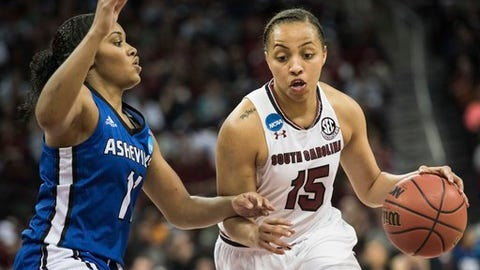 South Carolina guard Tiffany Davis (15) dribbles around North Carolina Asheville guard Khaila Webb (11) during a first-round game in the women's NCAA college basketball tournament Friday, March 17, 2017, in Columbia, S.C. South Carolina defeated UNC Asheville 90-40. (AP Photo/Sean Rayford)