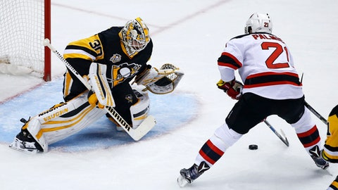 New Jersey Devils' Kyle Palmieri (21) finishes a break away with a goal against Pittsburgh Penguins goalie Matt Murray (30) in the first period of an NHL hockey game in Pittsburgh, Friday, March 17, 2017. (AP Photo/Gene J. Puskar)