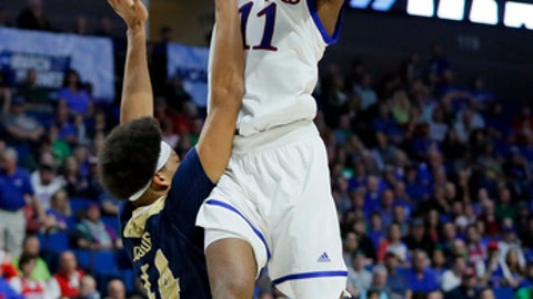 Kansas'Josh Jackson (11) goes up for a shot as UC Davis' Garrison Goode (44) defends in the second half of a first-round game in the men's NCAA college basketball tournament in Tulsa, Okla., Friday March 17, 2017. (AP Photo/Tony Gutierrez)