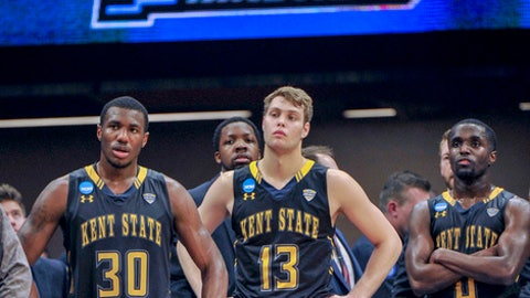 Kent State's Deon Edwin, left, Mitch Peterson, center, and Jalen Avery, right, watch the closing moments of the team's first-round game against UCLA in the NCAA men's college basketball tournament in Sacramento, Calif., Friday, March 17, 2017. UCLA won 97-80. (AP Photo/Bryan Patrick)