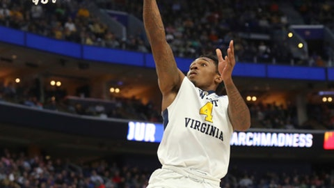 West Virginia guard Daxter Miles Jr. (4) drives to the basket against Notre Dame during the first half of a second-round men's college basketball game in the NCAA Tournament, Saturday, March 18, 2017, in Buffalo, N.Y. (AP Photo/Bill Wippert)