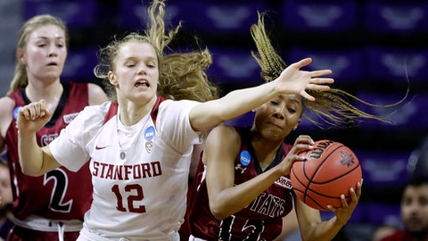 Stanford's Brittany McPhee, left, and New Mexico State's Zaire Williams chase a loose ball during the first half of a first-round game in the NCAA women's college basketball tournament Saturday, March 18, 2017, in Manhattan, Kan. (AP Photo/Charlie Riedel)
