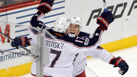 Columbus Blue Jackets right wing Cam Atkinson (13) celebrates with center Brandon Dubinsky (17) after scoring the winning goal against the New York Islanders in overtime of an NHL hockey game, Saturday, March 18, 2017, in New York. The Blue Jackets won 3-2. (AP Photo/Julie Jacobson)