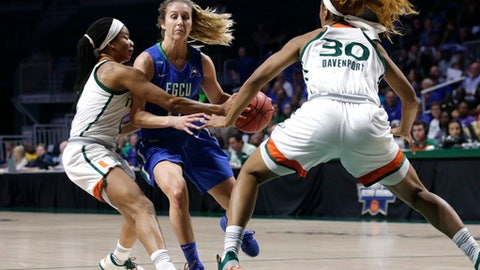 Florida Gulf Coast's Jordin Alexander, center, drives to the basket as Miami's Keyanna Harris, left, and Erykah Davenport (30) defend during the first half of a first-round game in the NCAA women's college basketball tournament, Saturday, March 18, 2017, in Coral Gables, Fla. (AP Photo/Lynne Sladky)