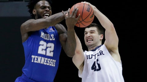 Middle Tennessee State's JaCorey Williams and Butler's Andrew Chrabascz battle for a rebound during the first half of an NCAA college basketball tournament second-round game Saturday, March 18, 2017, in Milwaukee. (AP Photo/Kiichiro Sato)