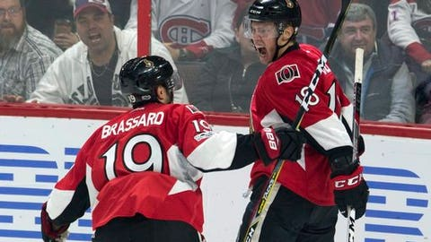 Ottawa Senators left wing Ryan Dzingel (18) celebrates his goal with teammate Derick Brassard during second-period NHL hockey game action against the Montreal Canadiens in Ottawa, Ontario, Saturday, March 18, 2017. (Adrian Wyld/The Canadian Press via AP)