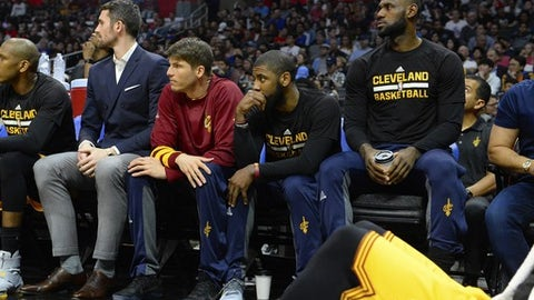 LOS ANGELES, CA - MARCH 18:  (left to right) Kevin Love #0, Kyle Korver #26, Kyrie Irving #2 and Lebron James #23 of the Cleveland Cavaliers sitting out the game against the Los Angeles Clippers on March 18, 2017 at STAPLES Center in Los Angeles, California. NOTE TO USER: User expressly acknowledges and agrees that, by downloading and or using this photograph, User is consenting to the terms and conditions of the Getty Images License Agreement.  (Photo by Robert Laberge/Getty Images)