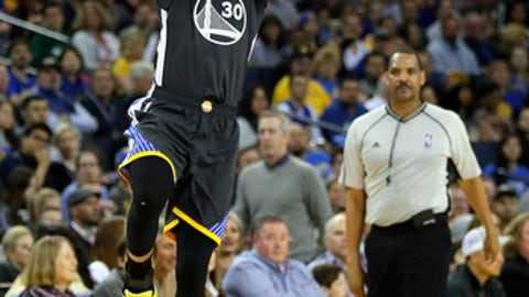 OAKLAND, CA - MARCH 18:  Stephen Curry #30 of the Golden State Warriors shots a three-pointer during the game against the Milwaukee Bucks at ORACLE Arena on March 18, 2017 in Oakland, California.  (Photo by Jamie Squire/Getty Images)