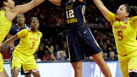 West Virginia guard Chania Ray (12) shoots against Maryland center Brionna Jones, left, guard Kaila Charles (3) and guard Destiny Slocum (5) in the first half of a second-round game in the women's NCAA college basketball tournament in College Park, Md., Sunday, March 19, 2017. (AP Photo/Patrick Semansky)