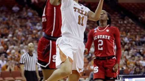 Texas guard Brooke McCarty (11) shoots past North Carolina State forward DD Rogers (21) during a second-round game in the NCAA women's college basketball tournament, Sunday, March 19, 2017, in Austin, Texas. (AP Photo/Eric Gay)