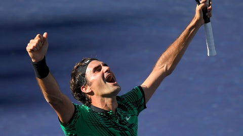 Roger Federer, of Switzerland, celebrates his win against Stan Wawrinka, also of Switzerland, in their final match at the BNP Paribas Open tennis tournament, Sunday, March 19, 2017, in Indian Wells, Calif. (AP Photo/Mark J. Terrill)