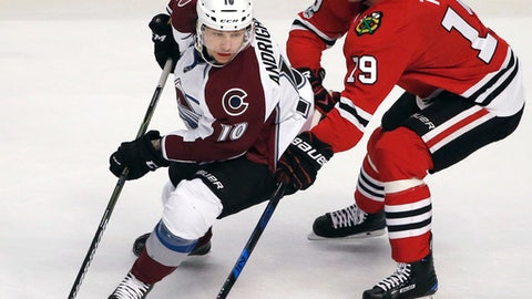 Colorado Avalanche right wing Sven Andrighetto, left, controls the puck against Chicago Blackhawks center Jonathan Toews during the first period of an NHL hockey game Sunday, March 19, 2017, in Chicago. (AP Photo/Nam Y. Huh)