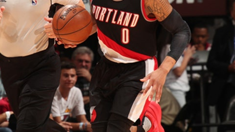 MIAMI, FL - MARCH 19: Damian Lillard #0 of the Portland Trail Blazers handles the ballagainst the Miami Heat on March 19, 2017 at AmericanAirlines Arena in Miami, Florida. NOTE TO USER: User expressly acknowledges and agrees that, by downloading and or using this Photograph, user is consenting to the terms and conditions of the Getty Images License Agreement. Mandatory Copyright Notice: Copyright 2017 NBAE (Photo by Issac Baldizon/NBAE via Getty Images)