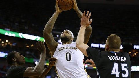 NEW ORLEANS, LA - MARCH 19: DeMarcus Cousins #0 of the New Orleans Pelicans shoots over Gorgui Dieng #5 of the Minnesota Timberwolves and Cole Aldrich #45 during the first half of a game at the Smoothie King Center on March 19, 2017 in New Orleans, Louisiana. NOTE TO USER: User expressly acknowledges and agrees that, by downloading and or using this photograph, User is consenting to the terms and conditions of the Getty Images License Agreement.  (Photo by Jonathan Bachman/Getty Images)