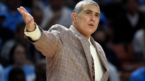 South Carolina head coach Frank Martin argues a call during the first half in a second-round game against Duke in the NCAA men's college basketball tournament in Greenville, S.C., Sunday, March 19, 2017. (AP Photo/Rainier Ehrhardt)