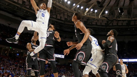 Duke's Jayson Tatum (0) dunks against South Carolina during the first half in a second-round game of the NCAA men's college basketball tournament in Greenville, S.C., Sunday, March 19, 2017. (AP Photo/Rainier Ehrhardt)