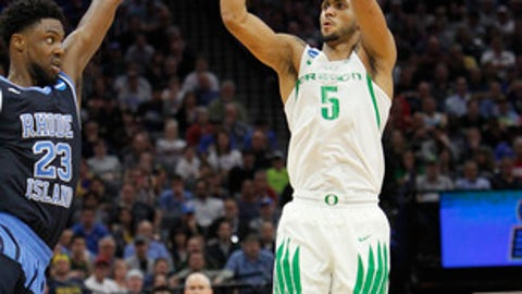 Oregon guard Tyler Dorsey (5) hits a 3-point shot over Rhode Island defender Kuran Iverson (23) in the final minute of an NCAA college basketball tournament second-round game in Sacramento, Calif., Sunday, March 19, 2017. Oregon won 75-72. (AP Photo/Steve Yeater)