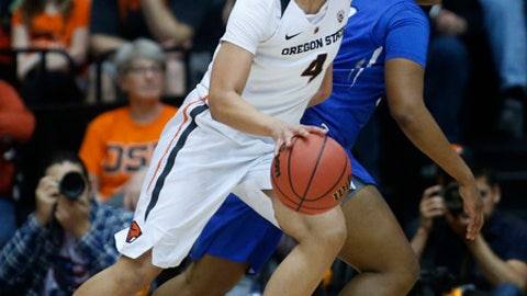 Oregon State's Breanna Brown (4) tries to get past Creighton's Brianna Rollerson, rear, during the first half of a second-round game in the NCAA women's college basketball tournament Sunday, March 19, 2017, in Corvallis, Ore. (AP Photo/Timothy J. Gonzalez)