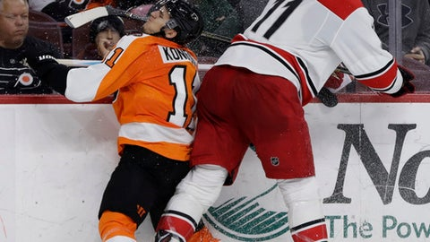 Carolina Hurricanes' Jordan Staal, right, collides with Philadelphia Flyers' Travis Konecny during the third period of an NHL hockey game, Sunday, March 19, 2017, in Philadelphia. Philadelphia won 4-3 in overtime. (AP Photo/Matt Slocum)