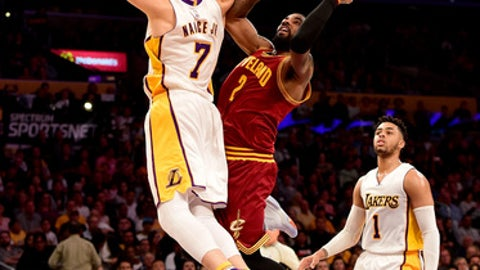 LOS ANGELES, CA - MARCH 19:  Kyrie Irving #2 of the Cleveland Cavaliers scores on Larry Nance Jr. #7 of the Los Angeles Lakers as D'Angelo Russell #1 look on during the first half at Staples Center on March 19, 2017 in Los Angeles, California.  NOTE TO USER: User expressly acknowledges and agrees that, by downloading and or using this photograph, User is consenting to the terms and conditions of the Getty Images License Agreement.  (Photo by Harry How/Getty Images)
