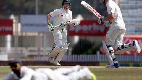 Australia's captain Steven Smith, left, and Matt Renshaw, right, run between the wickets to score runs during the fifth day of their third test cricket match against India in Ranchi, India, Monday, March 20, 2017. (AP Photo/Aijaz Rahi)