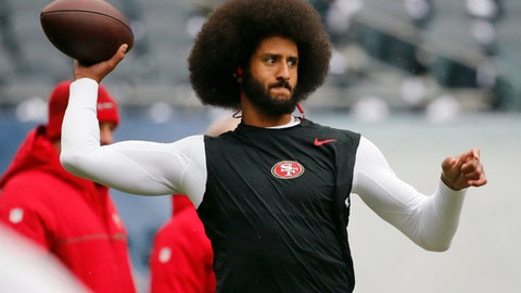 "FILE - In this Dec. 4, 2016, file photo, San Francisco 49ers quarterback Colin Kaepernick warms up before an NFL football game against the Chicago Bears. Spike Lee said on Instagram Sunday, March 19, 2017, that it was ""fishy"" that Kaepernick, now a free agent, hadn't been signed."" (AP Photo/Charles Rex Arbogast, File)"