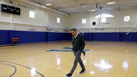 Villanova coach Jay Wright walks to a media availability at the NCAA college basketball team's practice facility, Monday, March 20, 2017, in Villanova, Pa. (AP Photo/Matt Slocum)