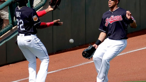 Cleveland Indians' Yandy Diaz (72) and Michael Brantley can't make the catch on a base hit by Los Angeles Dodgers' Chase Utley during the first inning of a spring training baseball game, Monday, March 20, 2017, in Goodyear, Ariz. (AP Photo/Matt York)
