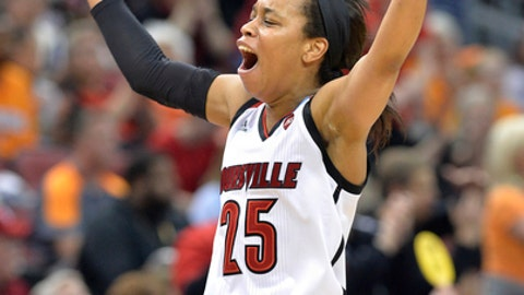 Louisville's Asia Durr celebrates after hitting a 3 point basket in the first half of a second-round game against Tennessee in the NCAA women's college basketball tournament, Monday, March. 20, 2017, in Louisville, Ky. (AP Photo/Timothy D. Easley)