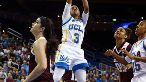 UCLA guard Jordin Canada, center, shoots against Texas A&M during the first half of a second-round game in the NCAA women's college basketball tournament, Monday, March 20, 2017, in Los Angeles. (AP Photo/Ringo H.W. Chiu)