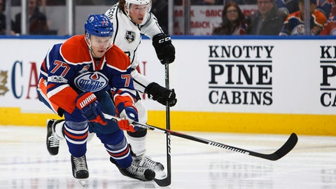 Edmonton Oilers' Oscar Klefbom (77) is chased by Los Angeles Kings' Tyler Toffoli (73) during the third period of an NHL hockey game in Edmonton, Alberta, Monday, March 20, 2017. (Codie McLachlan/The Canadian Press via AP)