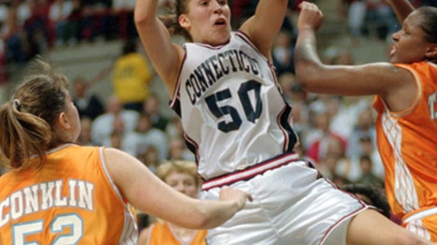 FILE - In this Jan. 16, 1995, file photo, Connecticut's Rebecca Lobo (50) pulls in a rebound as Tennessee's Abby Conklin (52) and Tiffani Johnson, right, defend during the first half of an NCAA college basketball game in Storrs, Conn. No current UConn player was even born the last time this program had a losing streak. And that mark is safe for at least another year, which has Rebecca Lobo thinking about popping the champagne with her former teammates _ the ones who actually lost two in a row. (AP Photo/Bob Child, File)